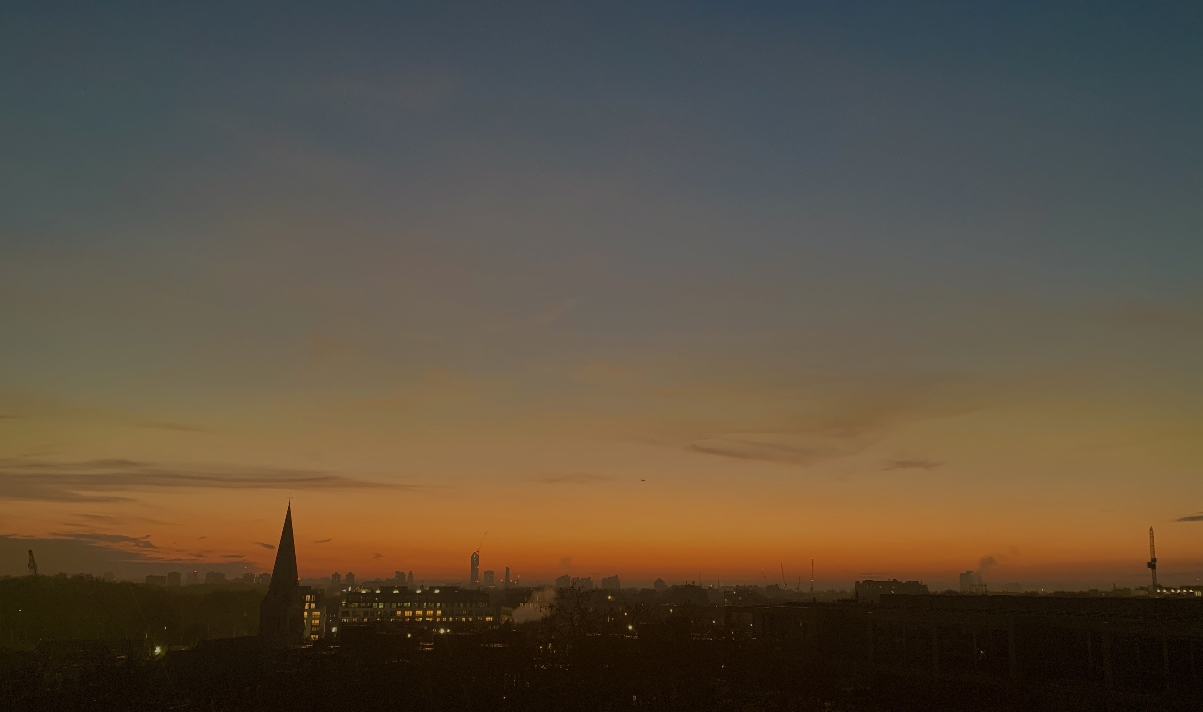 the sun sets on a winters day over London